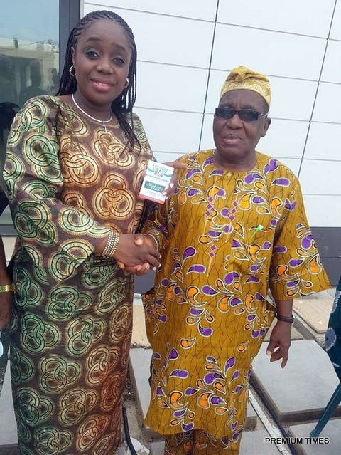 The Minister of Finance, Kemi Adeosun with the National Financial Secretary of the All Progressives Congress (APC), Alhaji Tajudeen Bello, after receiving her membership card of the APC in Abeokuta, Ogun State, on Saturday, 5th May, 2018